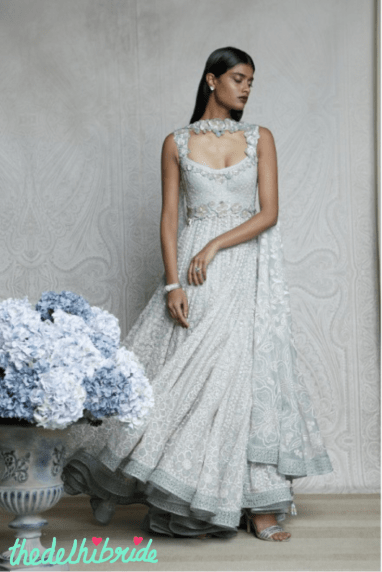 An elaborate, romantic, mint green anarkali with graded floral motifs, embroidered with ivory resham thread and lifted with opals, pearls and Swarovski Elements. Worn with a fully embroidered dupatta, beautifully structured and embellished like a neckpiece.