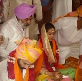Shahid & Mira sitting for their wedding ceremony
