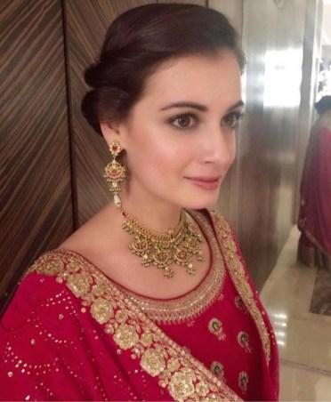 Wedding guest style - Sangeet - Dia Mirza in a red & hot pink Sabyasachi sharara detail closeup - hair and makeup - Masaba Gupta and Madhu Mantena Wedding 2015
