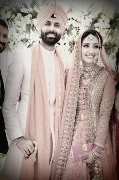 Wedding Wardrobe Shirin with Uday - Orange & Gold Sabyasachi jacket lehenga
