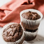 Three Double Chocolate Banana Muffins with a red napkin