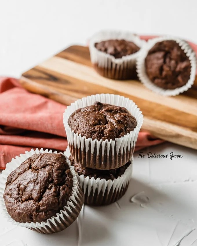 Double Chocolate Chip Muffins on a cutting board with red napkin