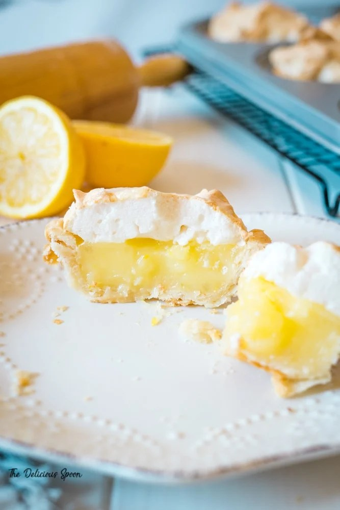 Picture of the inside of a lemon pie showcasing the layers on a white plate