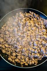Ground beef cooking in pan