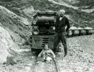 """Harry P. Gower and baby Mary Lillian Gower on the """"Baby Gauge Railroad"""" - Courtesy National Park Service, Death Valley National Park"""