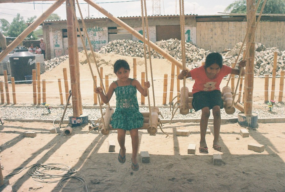 Children enjoying the newly constructed bamboo and rope swing.