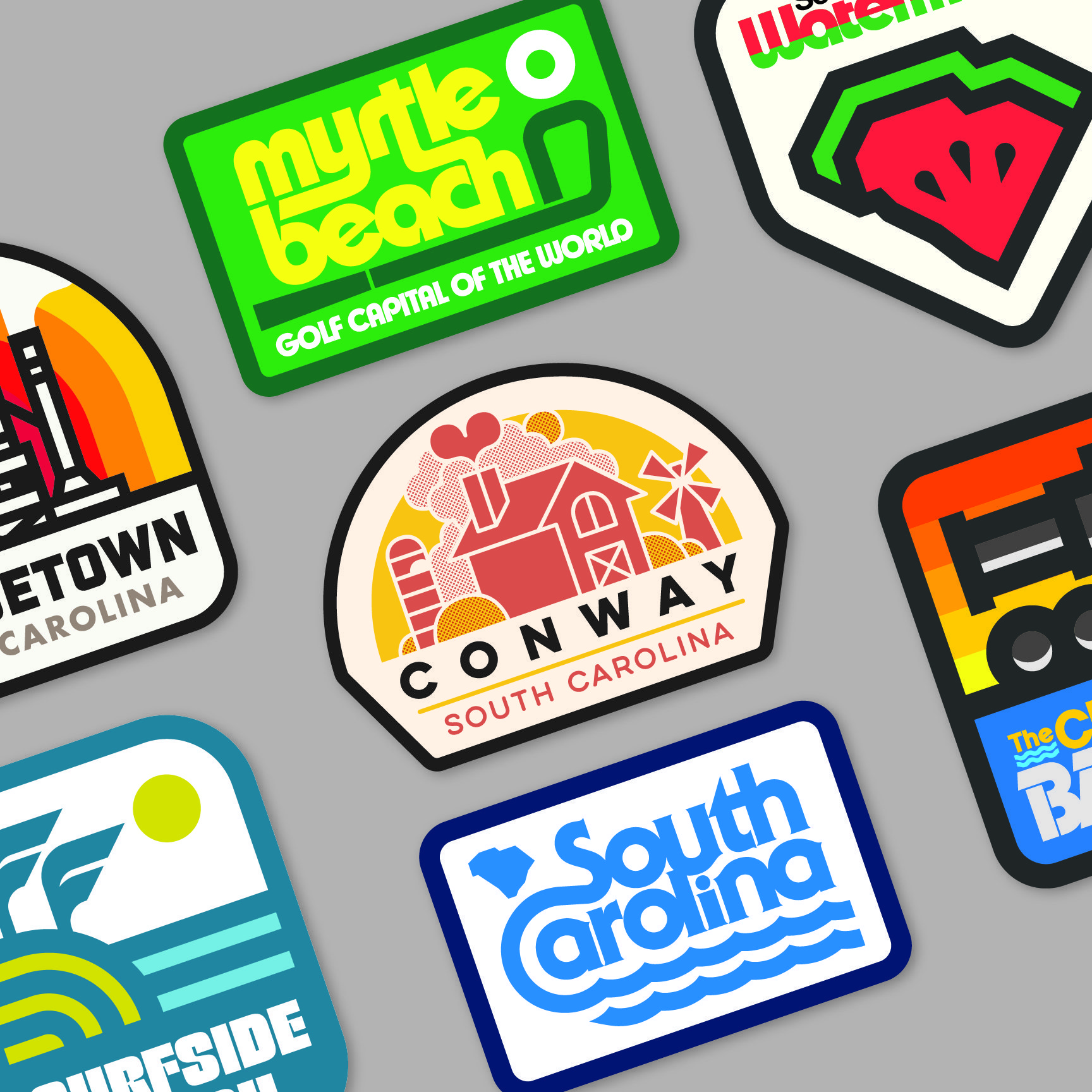 A collection of badges featuring towns of South Carolina