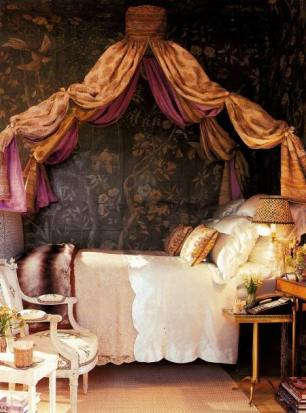 Designer Howard Slatkin's New York apartment. The guest room features a French Empire lit de voyage (portable bed) festooned with silk. An 18th-century Venetian lace coverlet and Louis XVI bedside table and armchair with embroidered period upholstery is in keeping with the sensibility of a chinchilla throw at the foot of the bed. | via http://www.atticmag.com/2010/08/extreme-decorating/