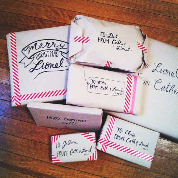 Catherine Cachia shared her Christmas gift wrapping skills with Pinterest. Doesn't get any simpler than this: white paper, striped neon washi tape and some creative penmanship! | via http://www.pinterest.com/pin/177540410282025163/