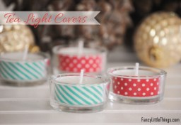 Nothing is easier than washi taping tea candles! It adds that special touch to your Xmas table - not to mention that it is super cute! | via http://www.fancylittlethings.com/2012/12/christmas-candle-covers/