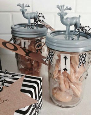 Kim Gray put together these trendy contemporary Christmas cookie jars. Don't you just love the black & white washi tape bunting and the quirky reindeer?! | http://www.kimgray.co.za/