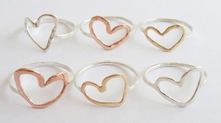 Love these heart rings by BellaReathe Jewellery. It comes in brass, copper & silver with a slightly hammered finish and looks great when stacked! Available at Utique.co.za | via http://www.utique.co.za/shop/brass-heart-ring/