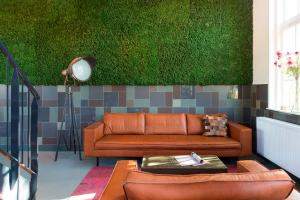 Moss wall accented with square and rectangular tiles image credit: Mosa Tile