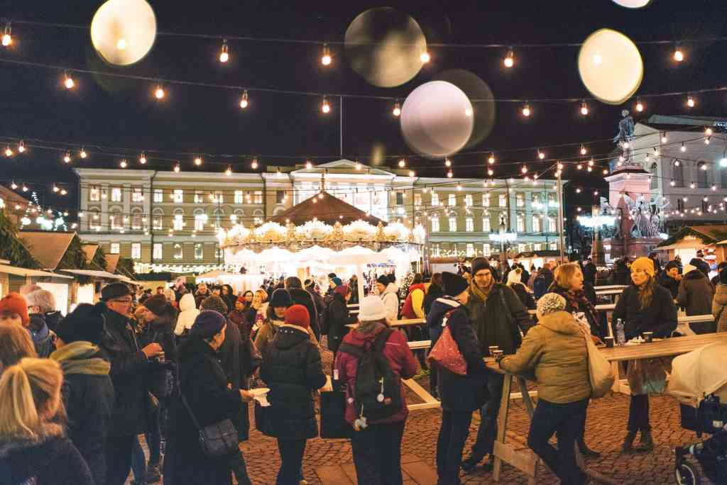 Food yard at the Christmas Market in Senate Square. For more design travel ideas, subscribe to the channel at youtube.com/TheDesignTourist