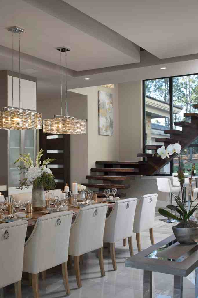 Progress Lighting fixtures in a linear configuration over the dining table in The 2018 New American Home