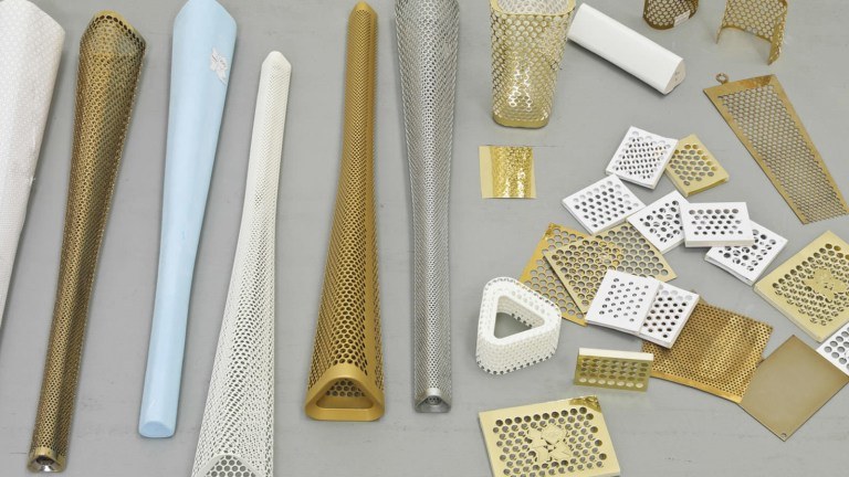 The Olympic Torch was designed by Barber Osgerby as a trilateral form perforated with 8000 circles. Image: supplied.