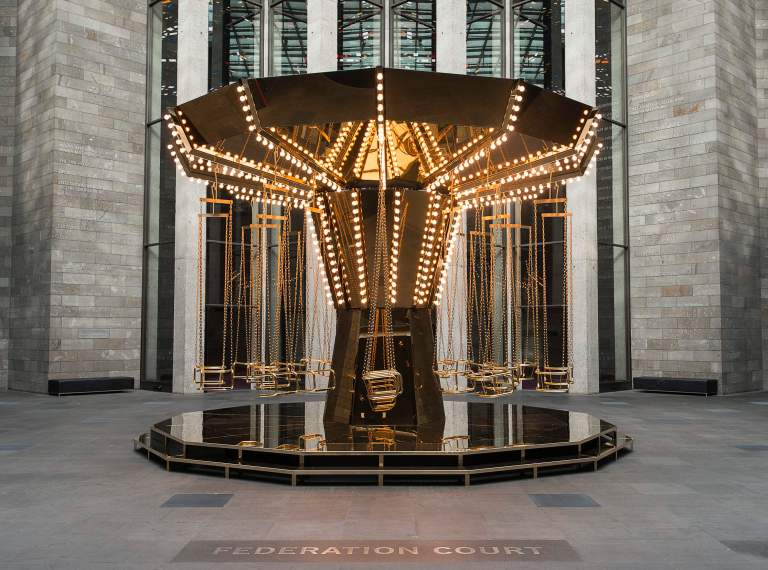 Carsten Höller German 1961–, worked in Sweden 2000– Golden mirror carousel 2014 powder-coated and painted steel, gold-plated stainless steel, tinite-plated stainless steel, brass, mirrors, light bulbs, electric motors, control unit, power unit, sandbags 480.0 x 745.0 cm diameter (variable) Collection of the artist, Stockholm and Gagosian Gallery, New York © Carsten Höller. Courtesy Gagosian Gallery Photo: Christian Markel