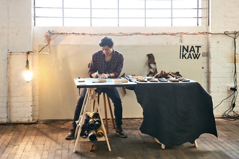 Nat Kaw demonstrating leatherwork at Factory Design District. Photo: Fiona Susanto
