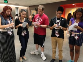 Students working together trying to see who committed the crime! #SJI14 Photo by Anita Luera