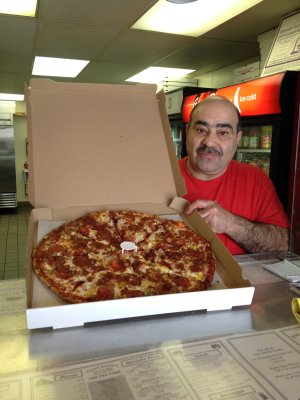Pierre himself with one of his enormous Brooklyn style pizzas