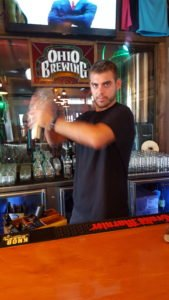 Bartender Charlie Meder shaking a cocktail