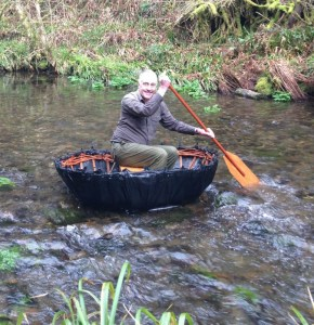 Volunteer ranger, Phil Ireland, finally mastering the replica coracle. Courtesy of the National Trust/Stephen Phillips