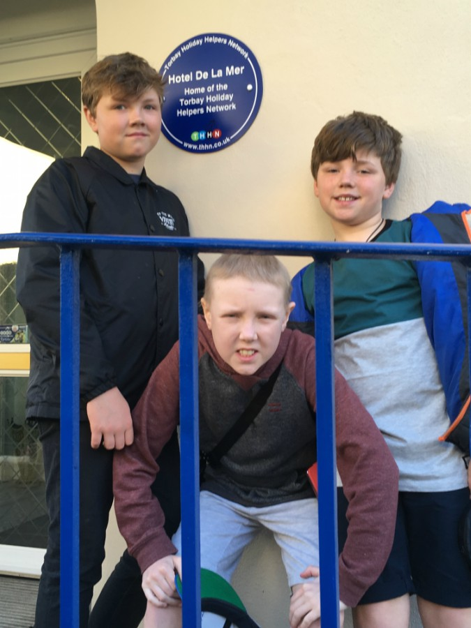 Jake Rees (centre) and his brothers enjoy a holiday in Torbay thanks to the Torbay Holiday Helpers Network.