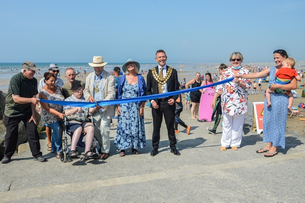 people cutting a ribbon on the new access at Westward Ho!