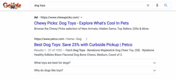 SEO vs PPC: example of organic and paid result in Google