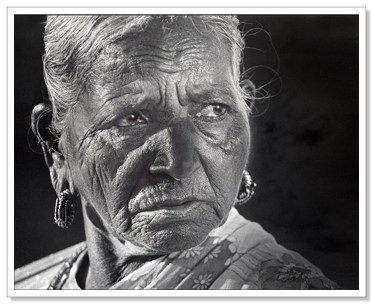 Wonderful portrait, the lady's life shows in her eyes. Again the tight cropping pulls the viewer in to the character of her wonderful face.