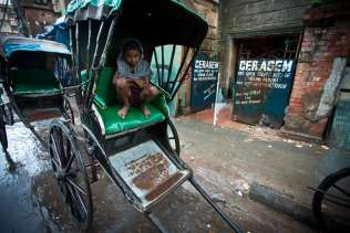 When not in use a rickshaw makes a handy resting place.