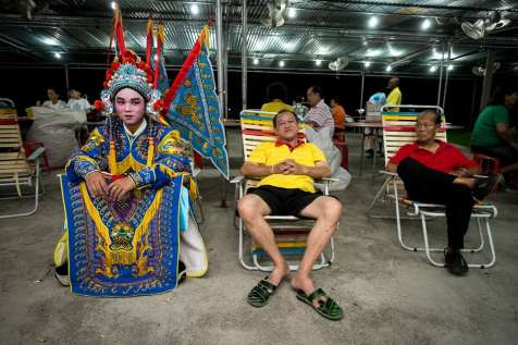 In costume and and make up performers now wait for the ceremonial blessing before the show.
