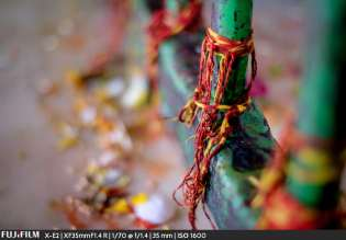 Mauli or kalava are red threads commonly tied to the wrists of Hindus when doing a puja or worship. Here they are tied to the altar.