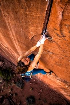 """Steph Davis climbing """"Hidden Gem"""" (13?) near Moab Utah."""