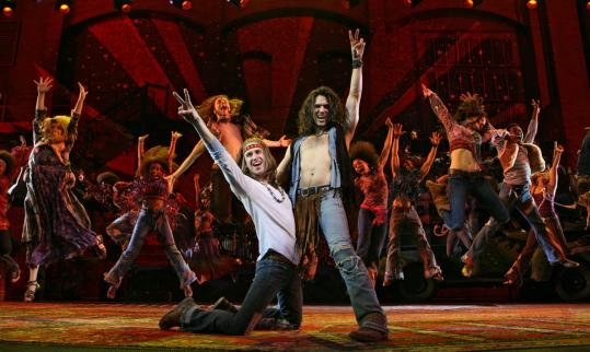 The cast of Hair, spreading peace and love.  And hair.