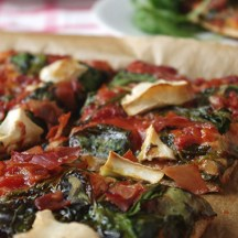 Wholemeal spinach, goats cheese and prosciutto pizza