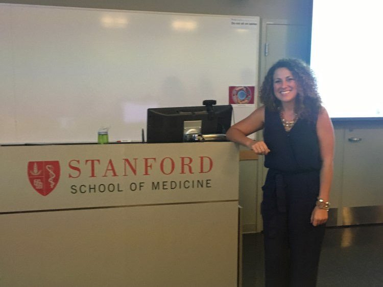 Julie presenting and sharing her journey at Stanford school of medicine.