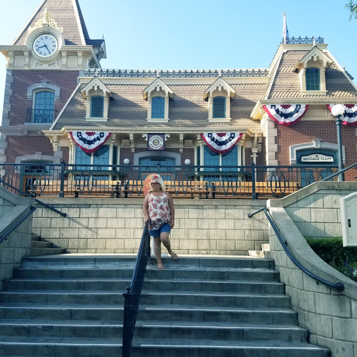 The Disabled Diva at Disneyland in front of the Disneyland Railroad Main Street station.