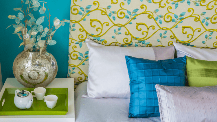 Bed with cool colored decor.