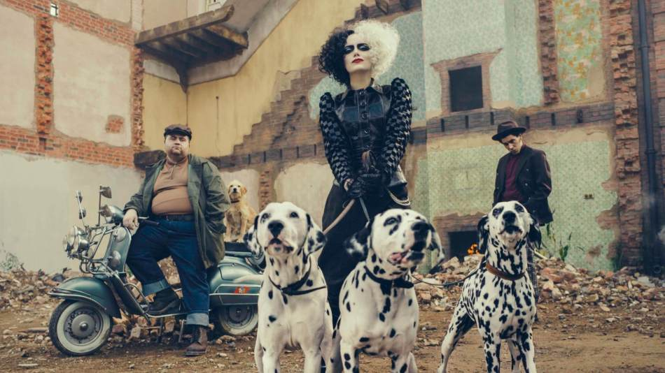 Paul Walter Hauser (left) as Horace, Emma Stone (center) as Cruella, and Joel Fry (right) as Jasper.