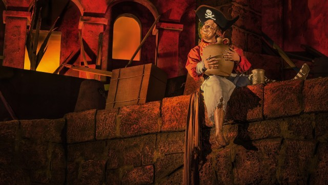 Pirate from Pirates of the Caribbean sitting on a bridge with his leg hanging down