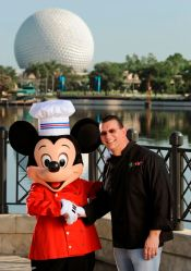 "Chef Robert Irvine from Food Network's ""Dinner Impossible,"" gets tips from Chef Mickey for his appearance at the Epcot International Food & Wine Festival at Walt Disney World Resort. Irvine will host the premium event ÒFood for ThoughtÓ Sept. 26, 1914, from 10 a.m.-noon; he'll also host a culinary demonstration at the Festival Center at 1 p.m. Sept. 27."
