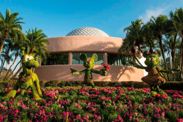 Mickey, Minnie and Pluto greet guests near Spaceship Earth during the Epcot International Flower & Garden Festival. The festival, which runs 75 days March 5-May 18, 2014 at Walt Disney World Resort in Lake Buena Vista, Fla., features dozens of character topiaries, stunning floral displays, workshops, the Flower Power concert series and presentations by HGTV personalities - all included in regular Epcot admission. (Matt Stroshane, photographer)