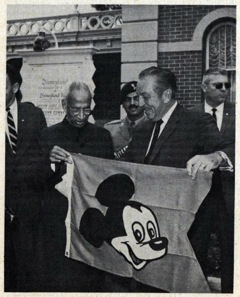 walt disney holding flag