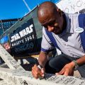 Disney's Hollywood Studios Cast Members Autograph Structural Beam for New Star Wars: Galaxy's Edge