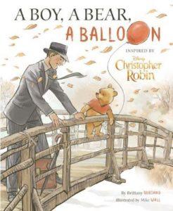 A boy A bear and a balloon