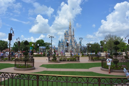 """A few of the new """"Hub"""" and """"Wishes"""" Fastpass+ Viewing area standing in front of the Plaza."""