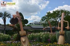 Monorail passes Sorcerer Mickey - - Epcot International Flower and Garden Festival 2015
