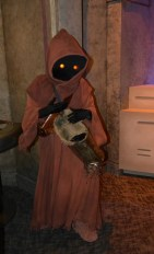 """Walt Disney World News February 7, 2016. The Jawas who have been appearing regularly in Launch Bay have been making less appearances. The official word inside Launch Bay is that they became stuck in a sand storm. That appears to have been temporary as they are appearing this morning. Be sure to take your items to """"barter""""."""