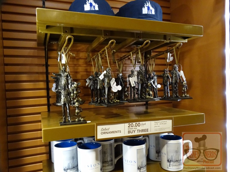Stop by Walt Disney Presents to find partner statue Christmas ornaments in the far back store. The second row of hats for sale that were removed last week apparently  made way for these favorite Disney ornament collectibles. Get one or more for your family Christmas tree next park visit!